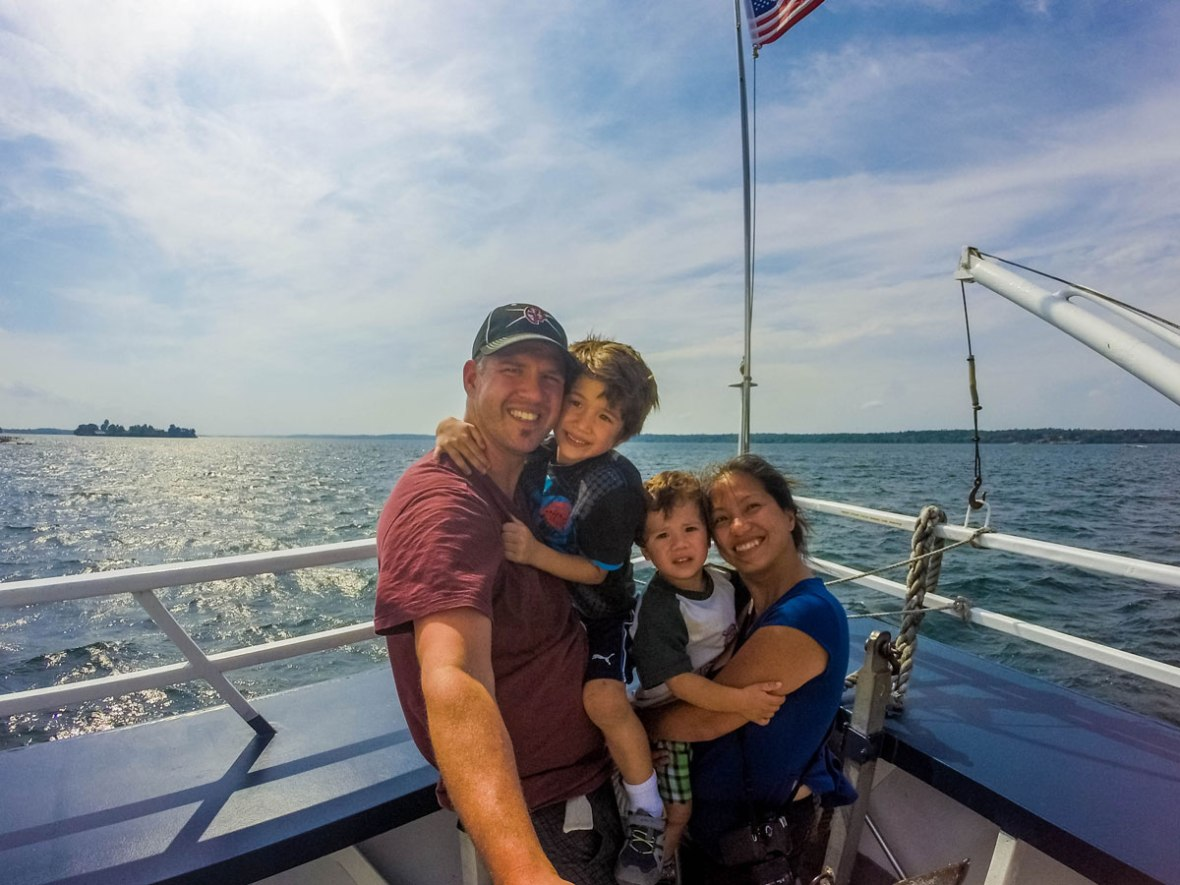 Family on boat for their castles in the Thousand Islands tour.