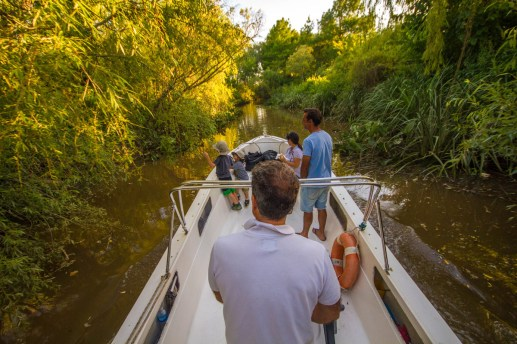 Boating through the narrow rivers of the delta Parana in Tigre, Argentina
