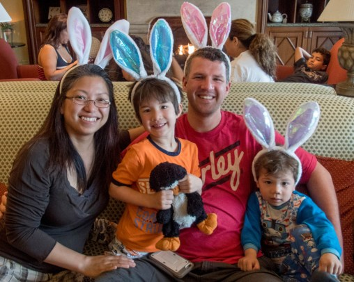A young family wearing bunny ears at an Easter breakfast in Bermuda