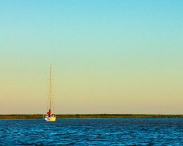 A sail boat on the Rio d la Plata near Tigre, Argentina