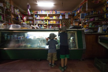 two young boys drool over the deserts at El Hornero restaurant on the delta Parana