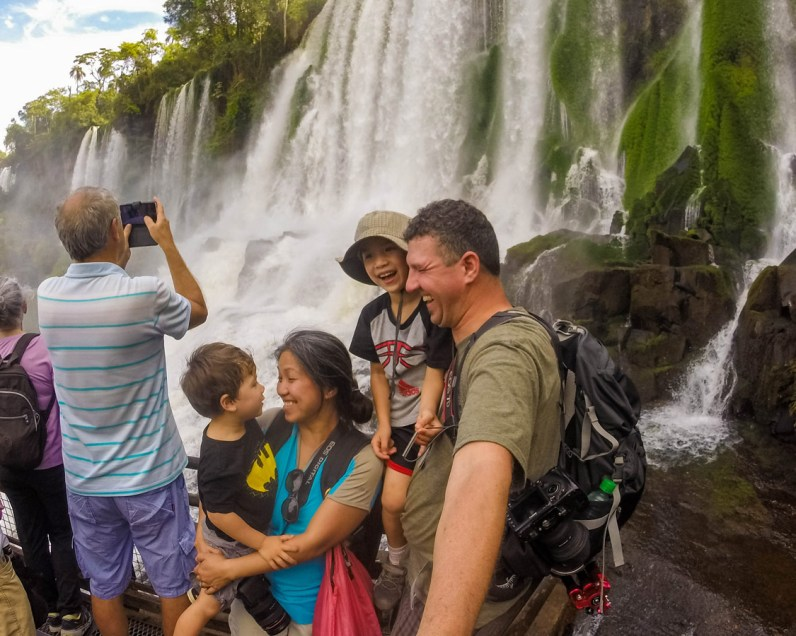 Family with kids gets wet at Salto Bosetti in Iguazu Falls Argentina with kids.