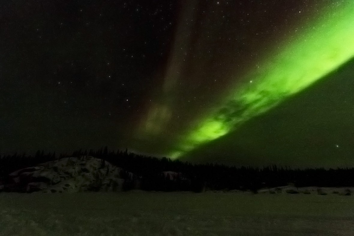 View of the Aurora Borealis (Northern Lights) outside of Yellowknife. One of the top things to do in Yellowknife is viewing the Auroroa borealis