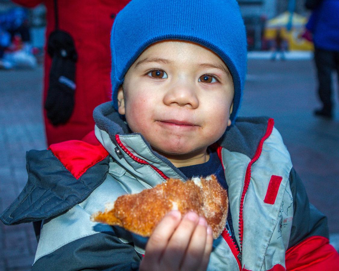 Boy eating a Beaver Tail.