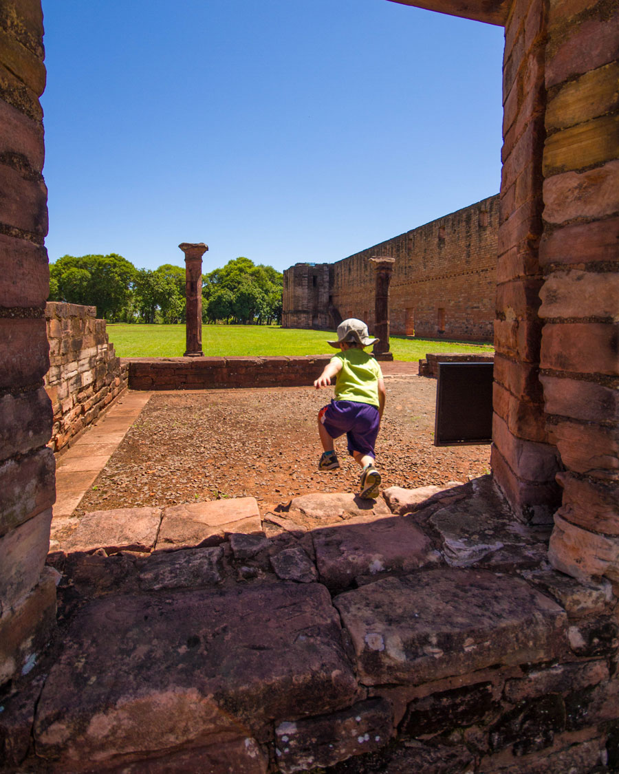A young boy jumps from the ledge of a window at Jesuit missions in Paraguay