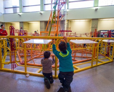 Two children look at a ball display at the Ontario Science Centre KidSpark display