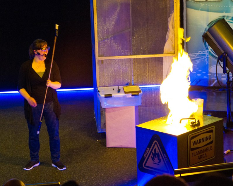 A scientist makes a sink explode in flame at the Ontario Science Centre Energy Show