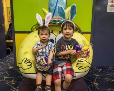 Two boys with their Easter baskets full of candy.