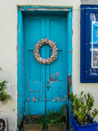 Beautiful blue door in an alleyway in historic St George Bermuda.