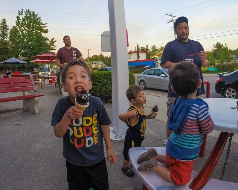 Boy eating an ice cream cone discovers What to do in Sauble Beach Ontario