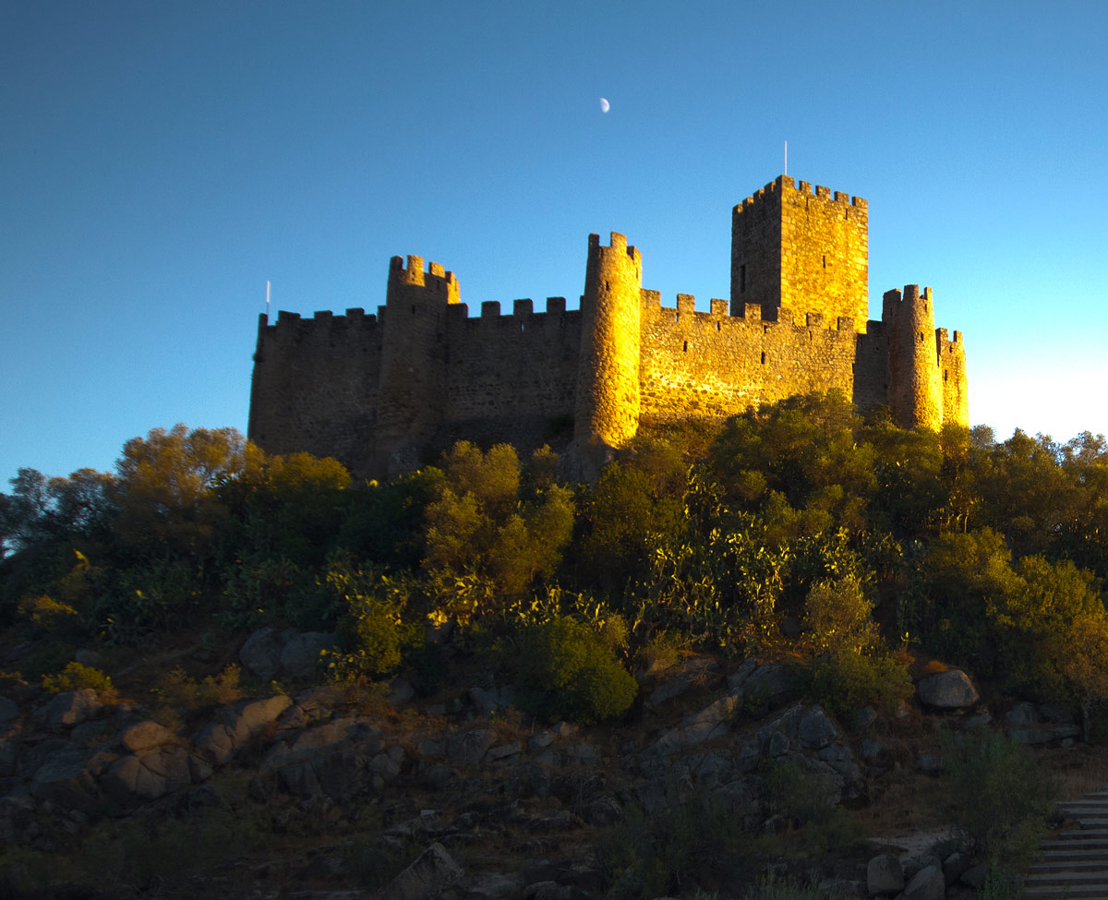 View of Castelo de Almoural in Portugal at sunset.
