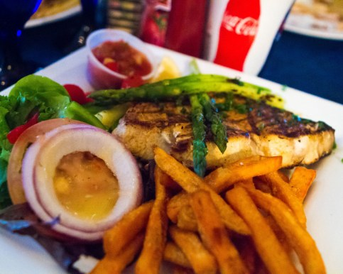 Fresh fish with french fries and salad from Wahoos Bistro and Pub.