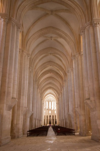 Long and narrow vaulted nave of Alcobaca Monastery in Portugal.