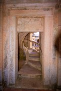 Hidden staircase at the corner of a cloister in Convento do Cristo in Tomar, Portugal.