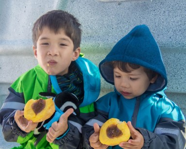 Two young boys eat Argentinian treats on a Dive Boat near Puerto Madryn Argentina