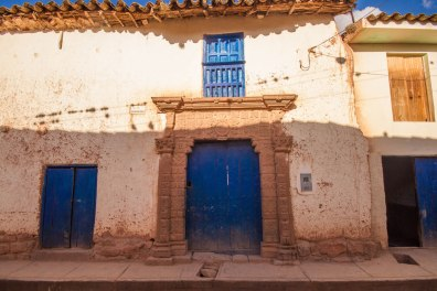 Beautiful blue doorway with an intricate trim in the town of Maras Peru