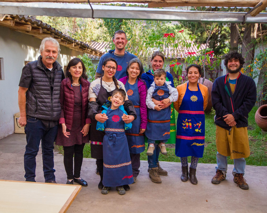 Pablo Seminario and Marilu Behar and their team at Taller Ceramica in Urubamba Peru pose with family travel writers Kevin Wagar and Christina Wagar and their children