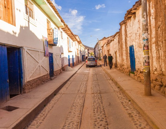 blue doors and adobe buildings in a beautiful street seen in Moray Peru on a daytrip to the Sacred Valley Peru