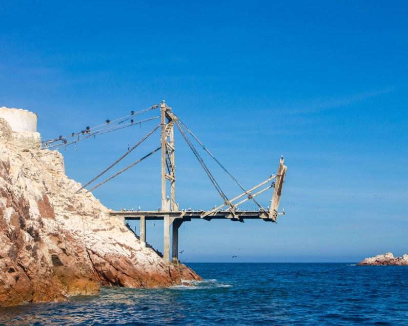 Birds line the docking port in the Ballestas Islands near Paracas Peru