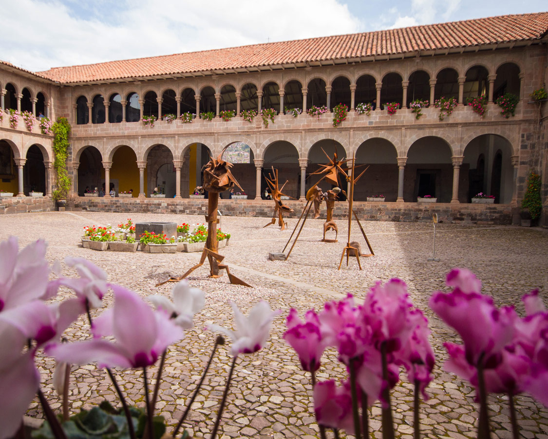 Flowers and artwork on display at Qorikancha, one of the top this to see in Cusco Peru