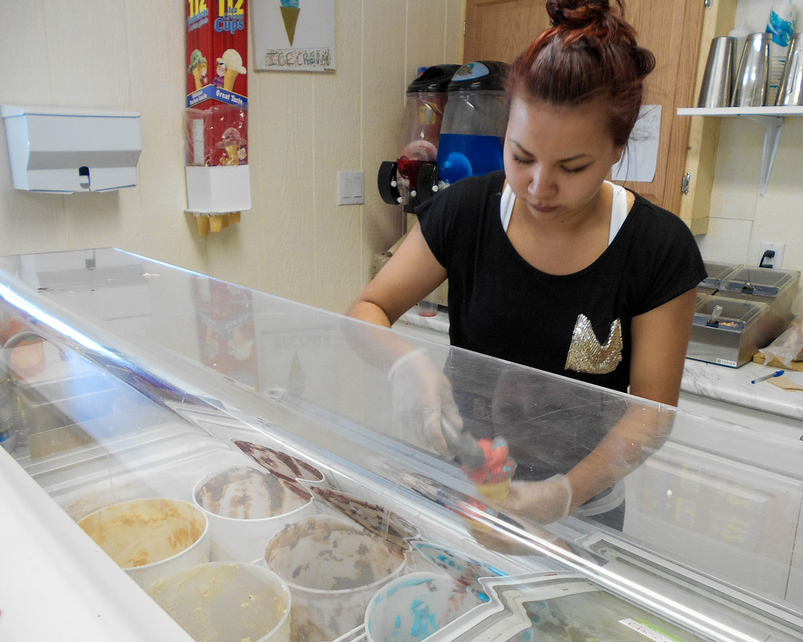 Scooping Faquhar's Dairy Ice Cream in M'Chigeeng Ontario. Tasting Farquhar's Ice Cream is one of the best things to do on Manitoulin Island
