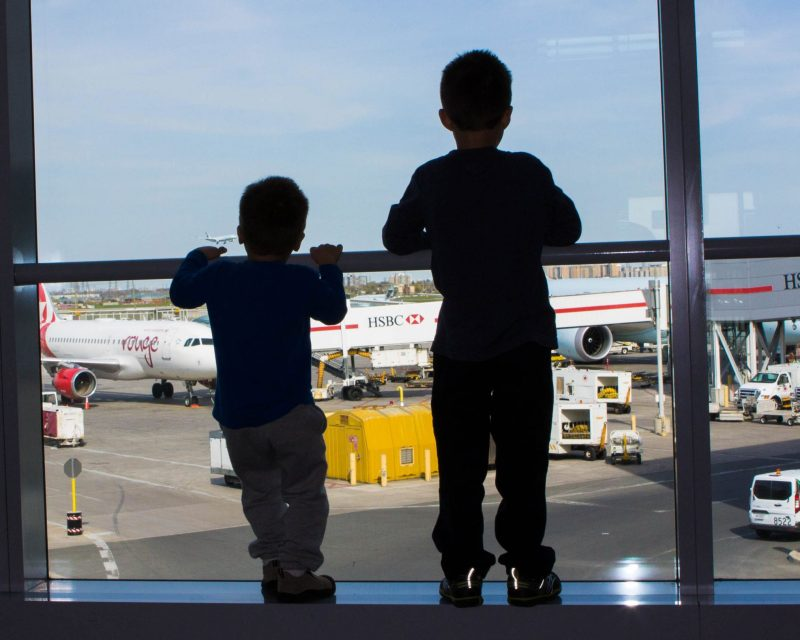 Boys waiting for a flight to Peru with kids at Toronto Pearson Airport for 2 weeks in Peru