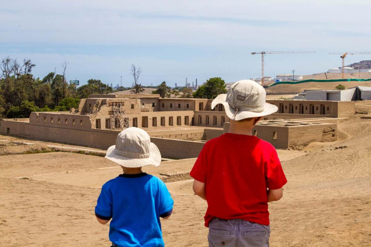Boys in front of Acclawasi in Pachacamac Peru with kids