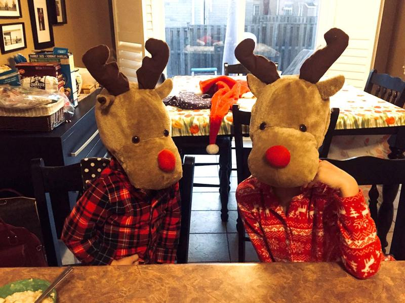 Kids in Reindeer hats at home