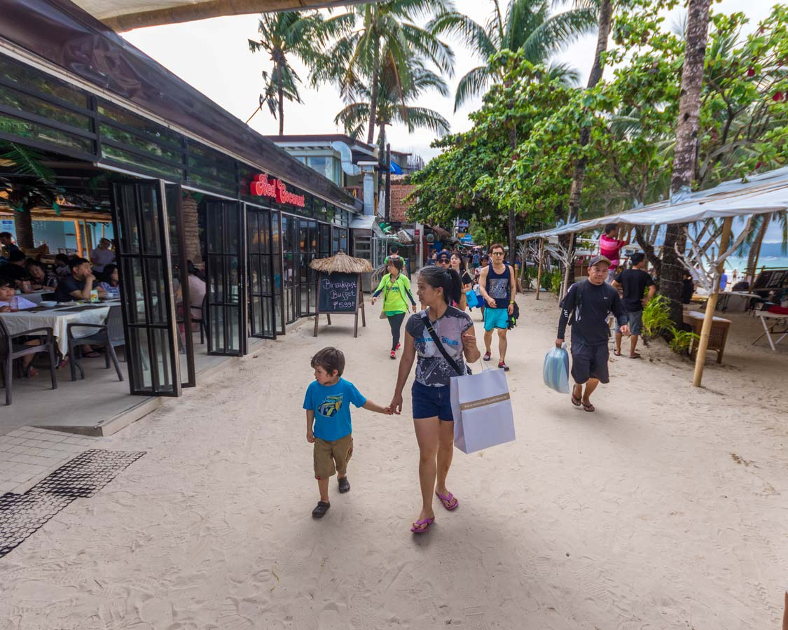 Shopping-atA woman and young son shopt at DMall in Boracay Philippines Station 2