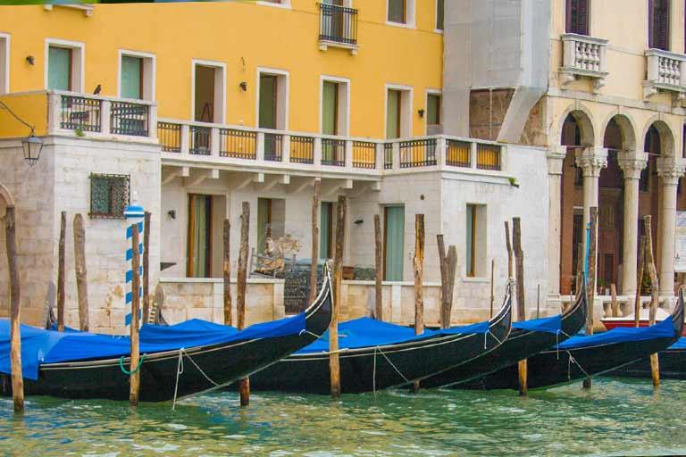 Gondolas in Venice for family travel in Italy