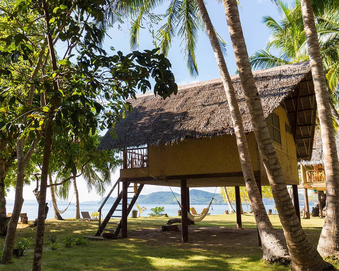 Wicker chalets at Sangat Island Resort