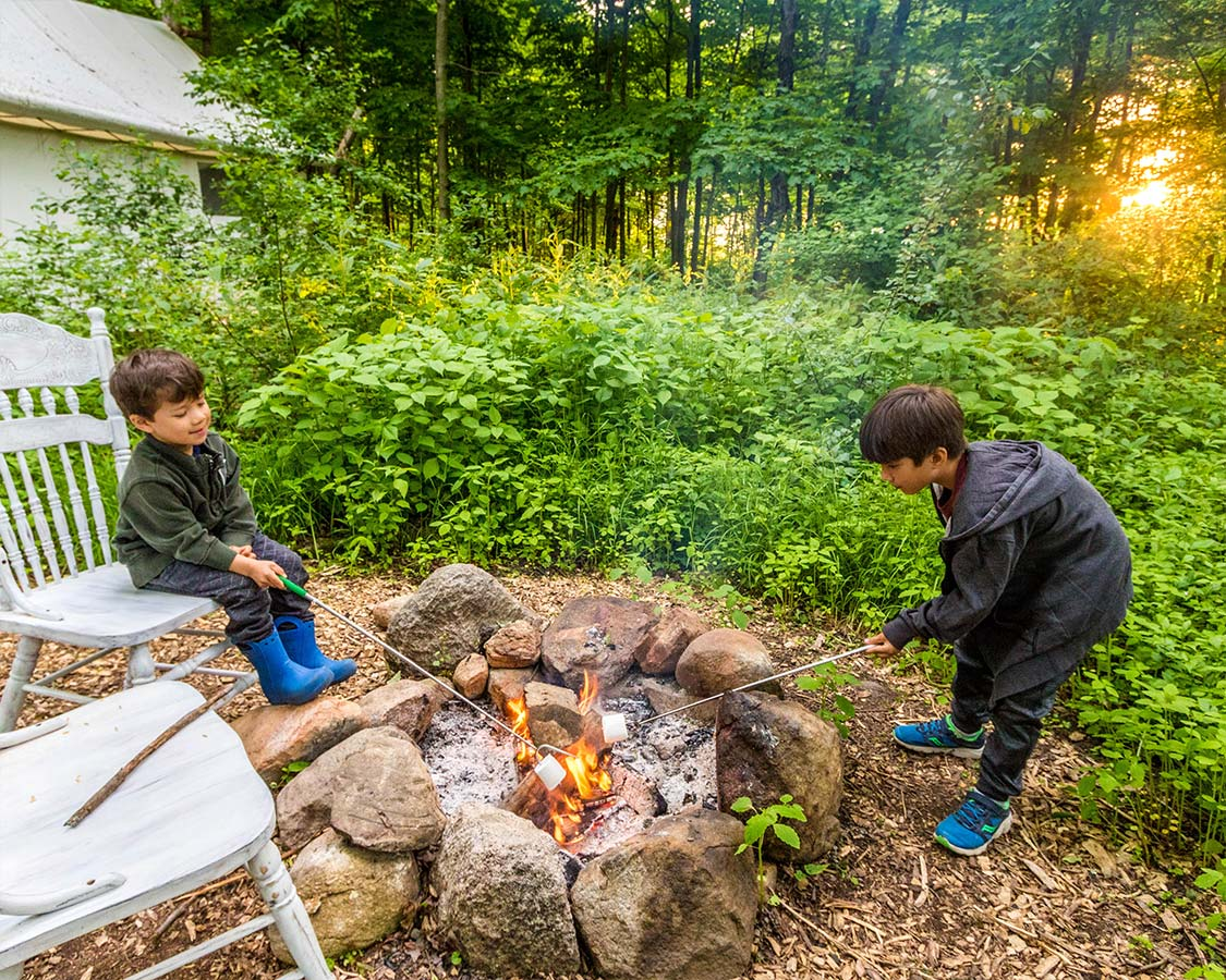 Kids Roasting Marshmallows at Fronterra Glamping in Prince Edward County
