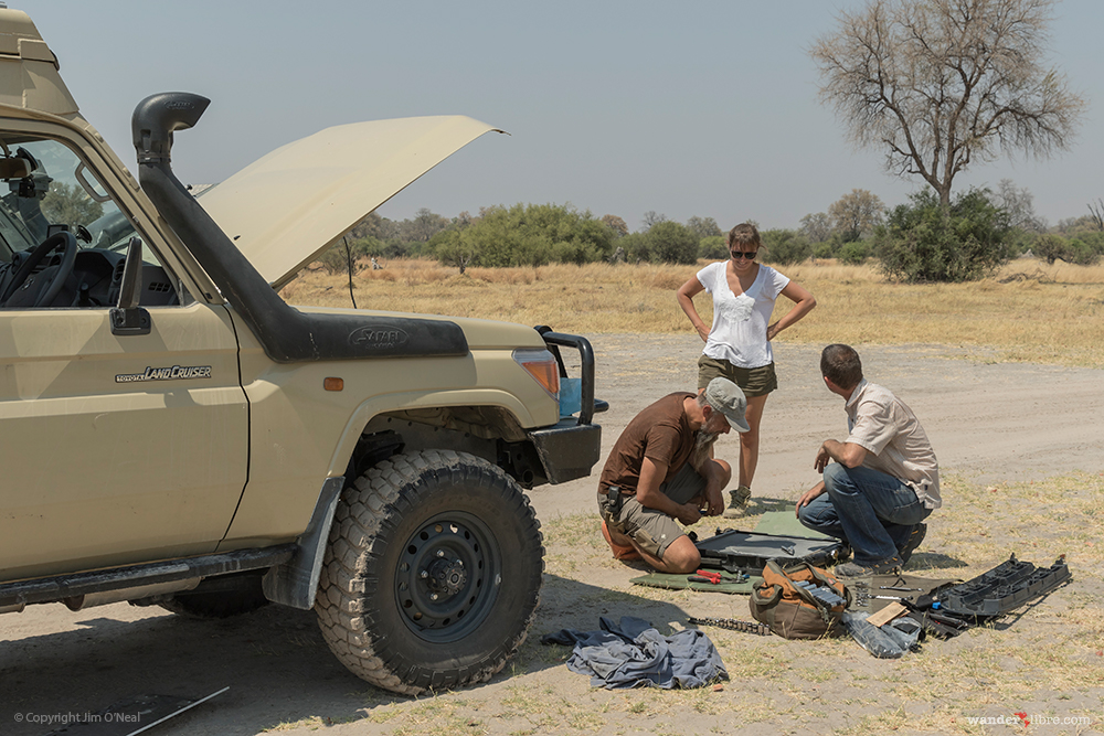 Assessing the Damaged Radiator After Pulling it Out of the Truck in Khwai, Botswana