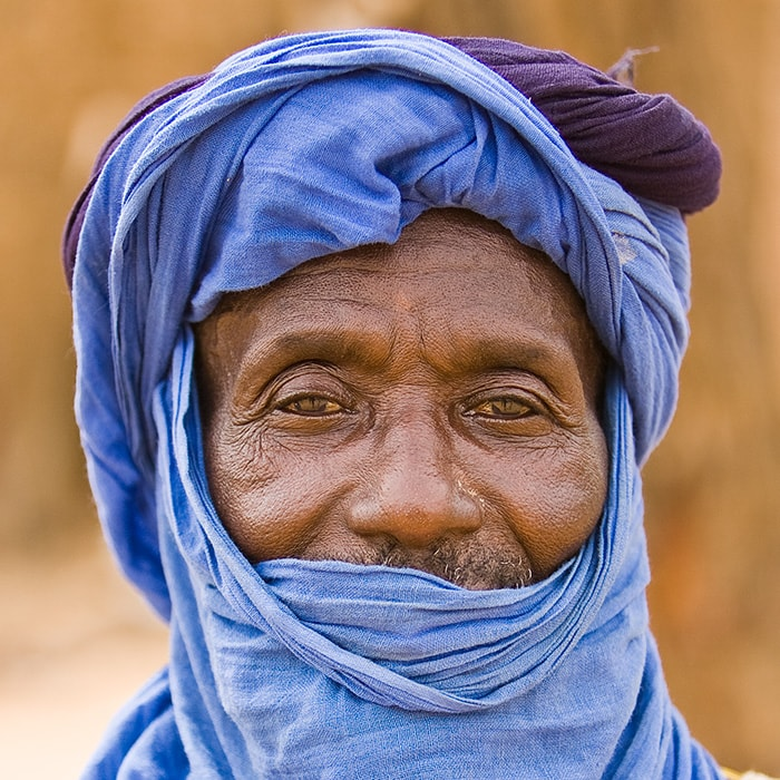A toureg dressed in blue at the market in Groom Groom Burkina Faso