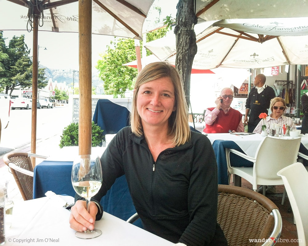 Sheri having a glass of wine in Franschhoek, South Africa