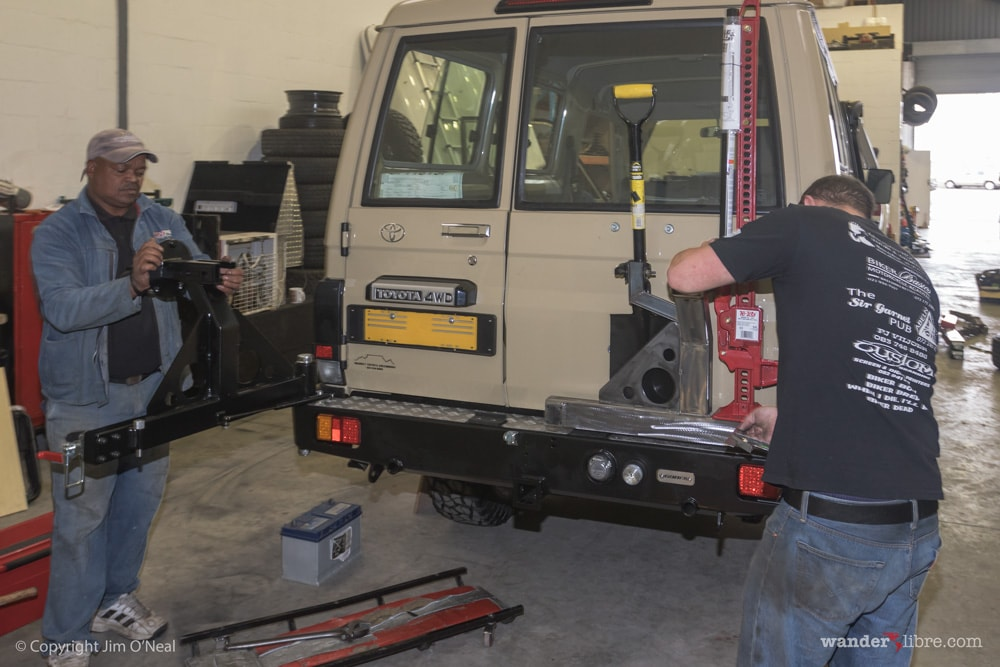 R&D Offroad customizing dual wheel carrier to hold shovel and hi-lift jack