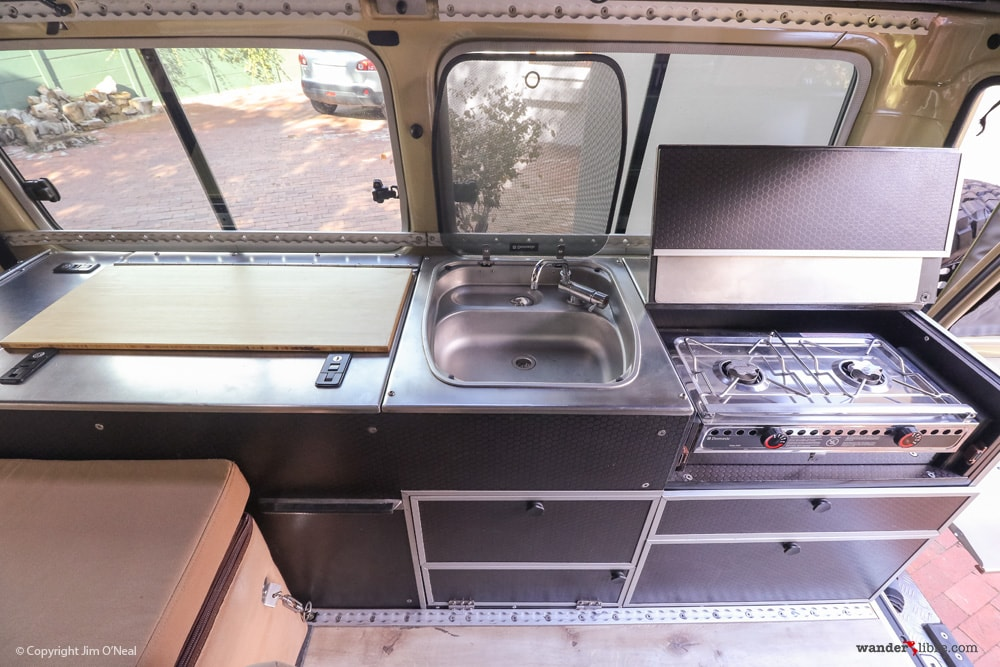 Land Cruiser Tiny Home Kitchen w/ Stainless Steel Counters, Sink, & Marine Alcohol Stove