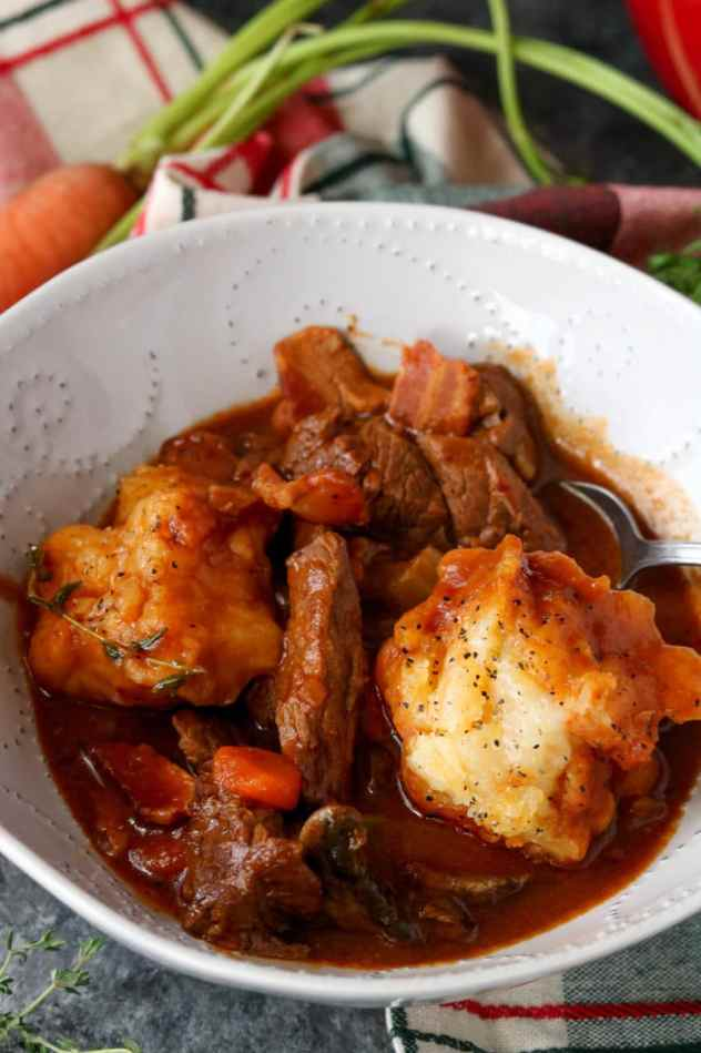 guinness beef stew with gluten free garlic cheddar dumplings