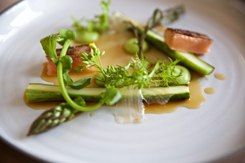 Pan-fried arctic char with asparagus, broccoli puree and browned butter sauce at Olo Restaurant, Helsinki