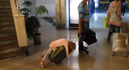 o-TIRED-GIRL-AIRPORT-SUITCASE-facebook