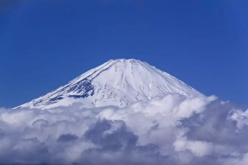 Close-up view of snow-capped Mount Fuji.