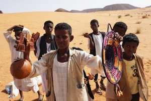 desert boys-selling souvenirs Pyramids of Meroe in Sudan