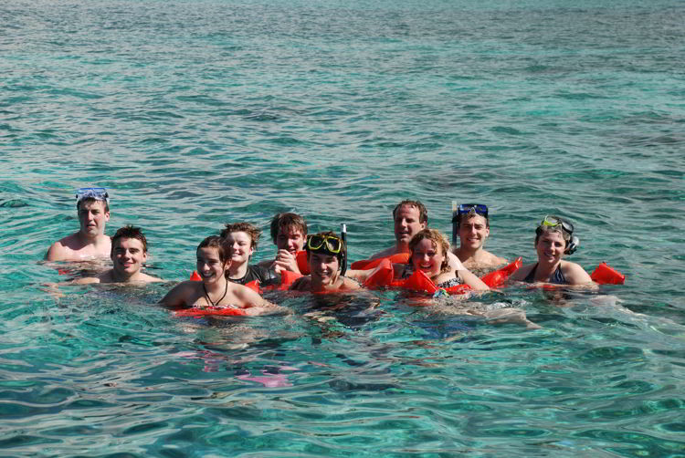An image of a family snorkeling together in Montego Bay, Jamaica - all inclusive family resorts