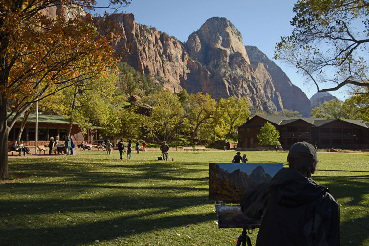 An image of a person painting a landscape in Zion National Park in Utah - Best Zion National Park Hikes