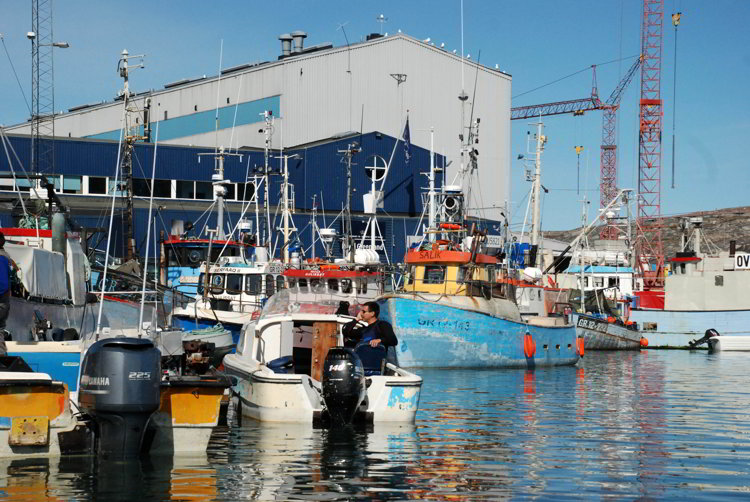 An image of boats in the Ilulissat Harbor in Ilulissat Greenland