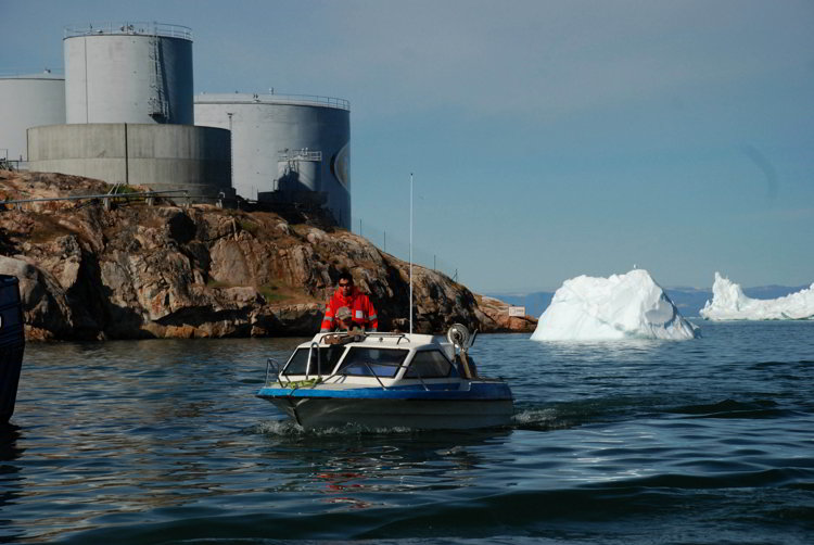 An image of a boat entering the harbor in Ilulissat, Greenland