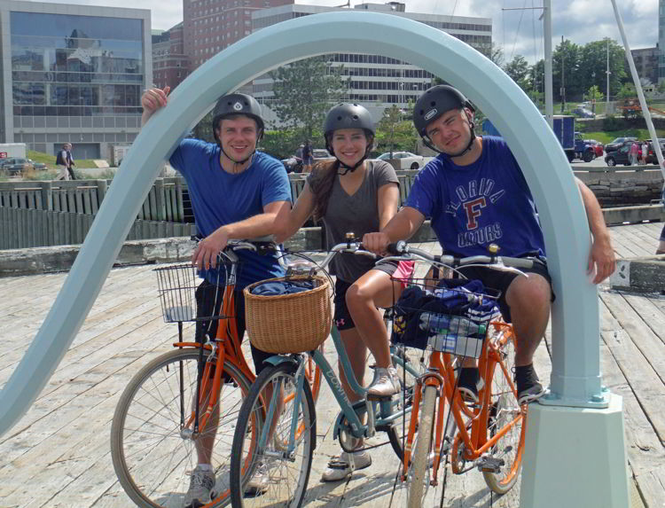 An image of three people on bikes at the Halifax Harbor in Halifax, Nova Scotia Canada - Halifax Tours