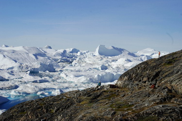 An image of people looking over the Ilulissat Icefjord in Ilulissat Greenland