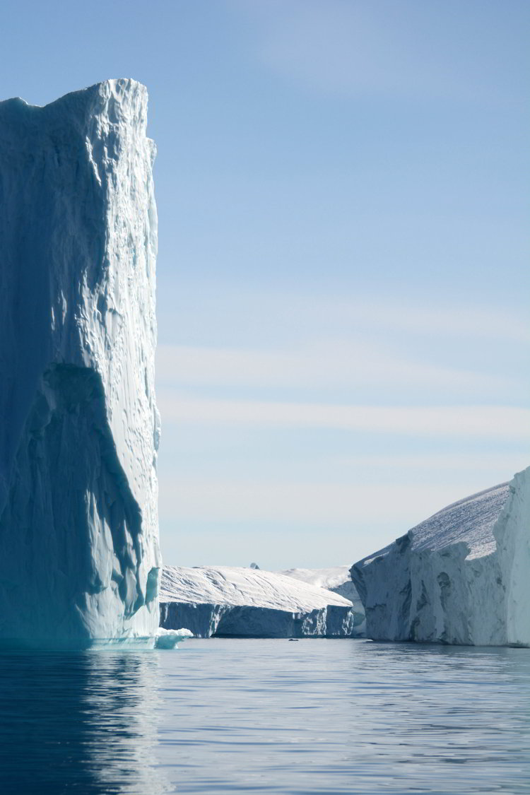 An image of three icebergs near Ilulissat Greenland