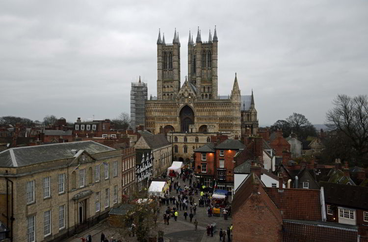 An image of Lincoln Cathedral and the Lincoln Christmas Market being set up in Lincolnshire, England.